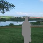 プリンス・エドワード島の芝生。緑の芝生、その後ろに川と農場と青空。